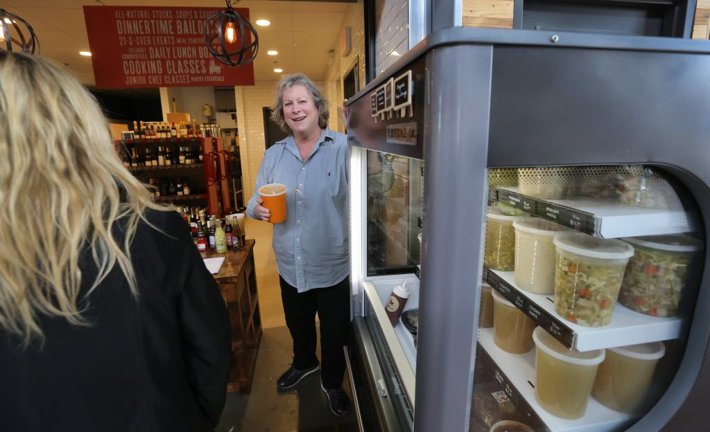 Joanne Bondy talks with customers at shop/restaurant Stocks and Bondy, located at the Dallas Farmers Market in downtown Dallas.
