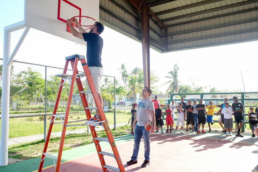 """Mavericks guard J.J. Barea and owner Mark Cuban help put the finishing touches on a basketball court in Puerto Rico that was destroyed by Hurricane Maria. The efforts of Barea, Cuban and others will be featured on an upcoming episode of the TV show """"Bar Rescue."""""""