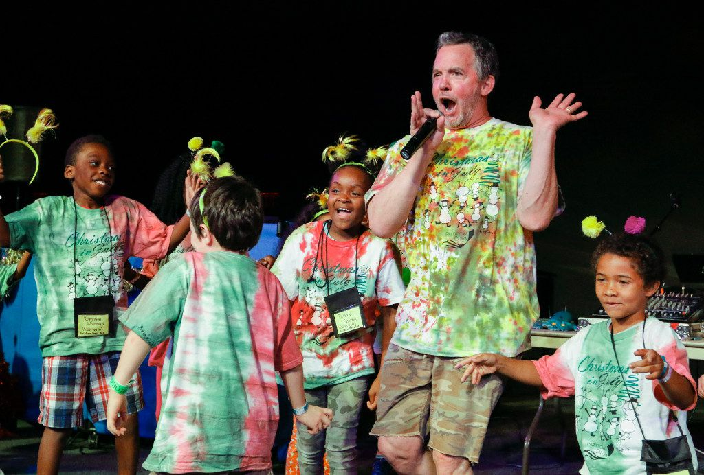 Dallas children's singer and songwriter Eddie Coker performs Friday with campers in a Christmas-themed show at Camp Bravo, held annually at Lovers Lane United Methodist Church. The camp was created in 1985 by Cathey Brown, founder and CEO of Rainbow Days, in 1985 to get kids out of Dallas shelters and allow them to express themselves in a safe environment.
