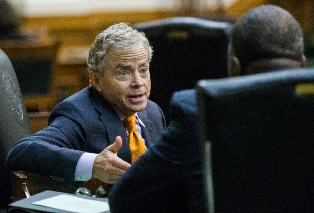 Senator Don Huffines talks to Senator Royce West during a midnight session during the third day of a special legislative session on Thursday, July 20, 2017 at the Texas state capitol in Austin, Texas. The midnight session was called to read and pass the Sunset Bill.