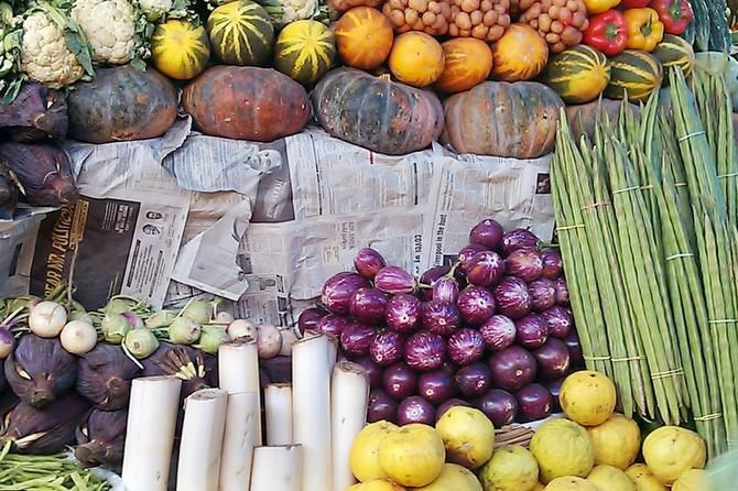 A cascade of fruits and vegetables at an open market in Kochi.