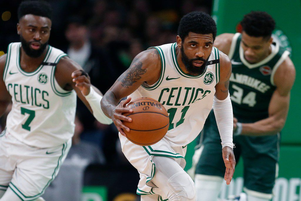 Boston Celtics' Kyrie Irving (11) brings the ball up court during the second half of Game 4 of a second round NBA basketball playoff series against the Milwaukee Bucks in Boston, Monday, May 6, 2019. (AP Photo/Michael Dwyer)