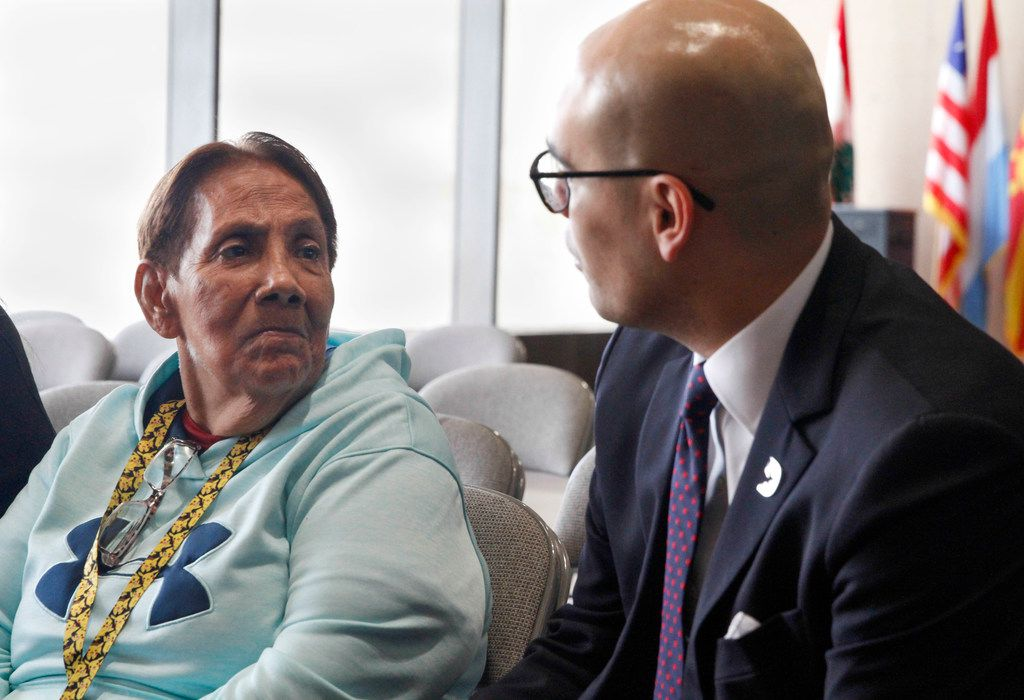 Dallas ISD trustee Miguel Solis spoke with Bessie Rodriguez, mother of Santos Rodriguez, after Thursday's vote to rename the Pike Park rec center after her son.