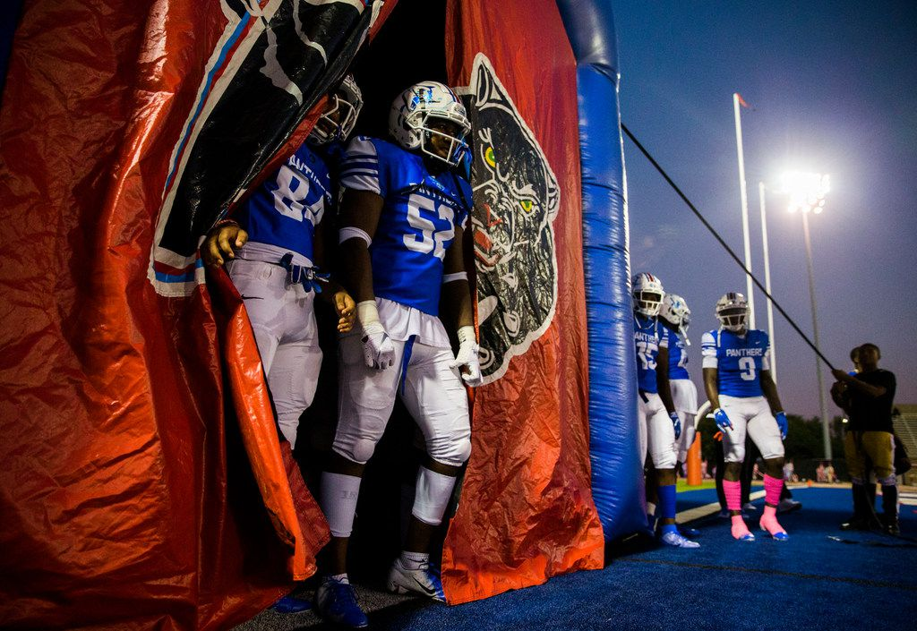 Duncanville football players wait to enter the field before a high school football game between Skyline and Duncanville on Friday, October 4, 2019 at Panther Stadium in Duncanville. (Ashley Landis/The Dallas Morning News)