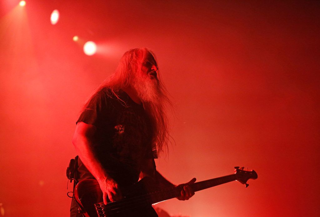 Bathed in red light and smoke, Lamb of God bassist John Campbell plays during the band's opening set for Slayer's final Dallas show Tuesday night at the Bomb Factory.