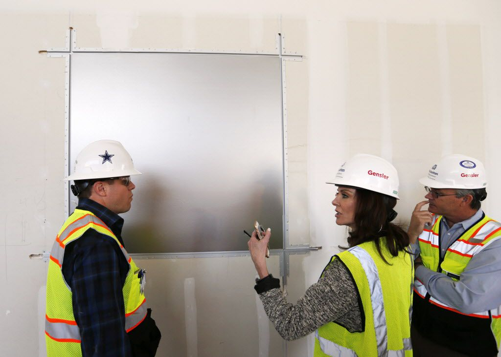 Charlotte Jones Anderson (left) Executive Vice President and Chief Brand Officer for the Dallas Cowboys talks about a wall application with Project Director Nicholas Link (left) of Manhattan Construction Company and Project Manager Mark Hickman of Legends at the Dallas Cowboys new headquarters at The Star in Frisco, on Tuesday, May 3, 2016. The Star a joint project with the City of Frisco is scheduled to open in August. (Vernon Bryant/The Dallas Morning News)