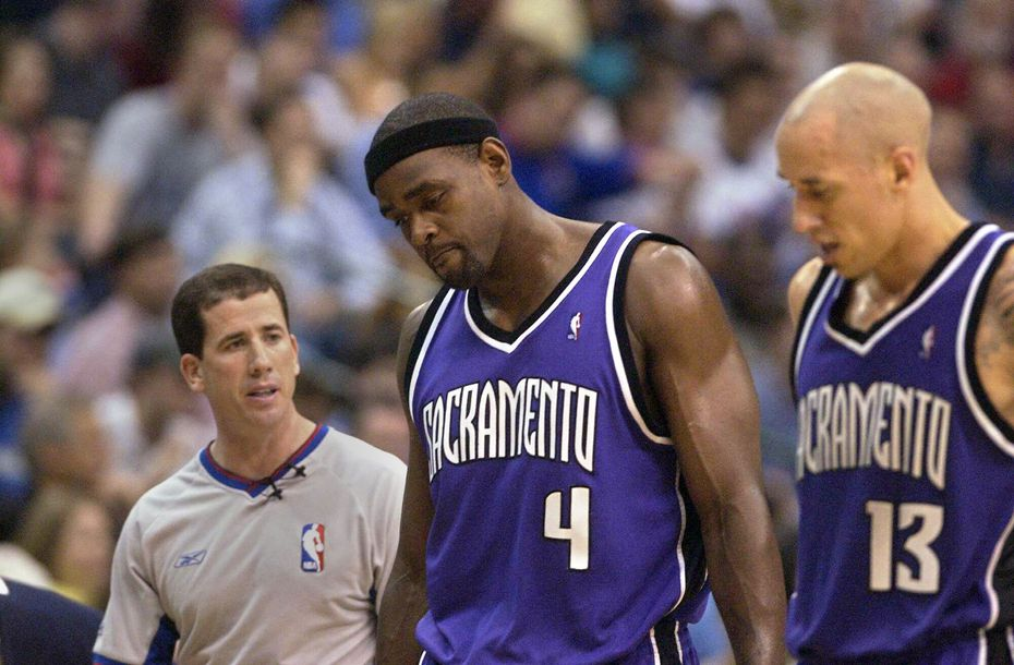 FILE - Chris Webber hangs his head after a second-quarter call, as Tim Donaghy (left) and Doug Christie surround him, during Game 3 of the first round of the Western Conference playoffs against the Mavericks on Saturday, April 24, 2004, at American Airlines Center in Dallas. (Jose Luis Villegas/Sacramento Bee photograph)