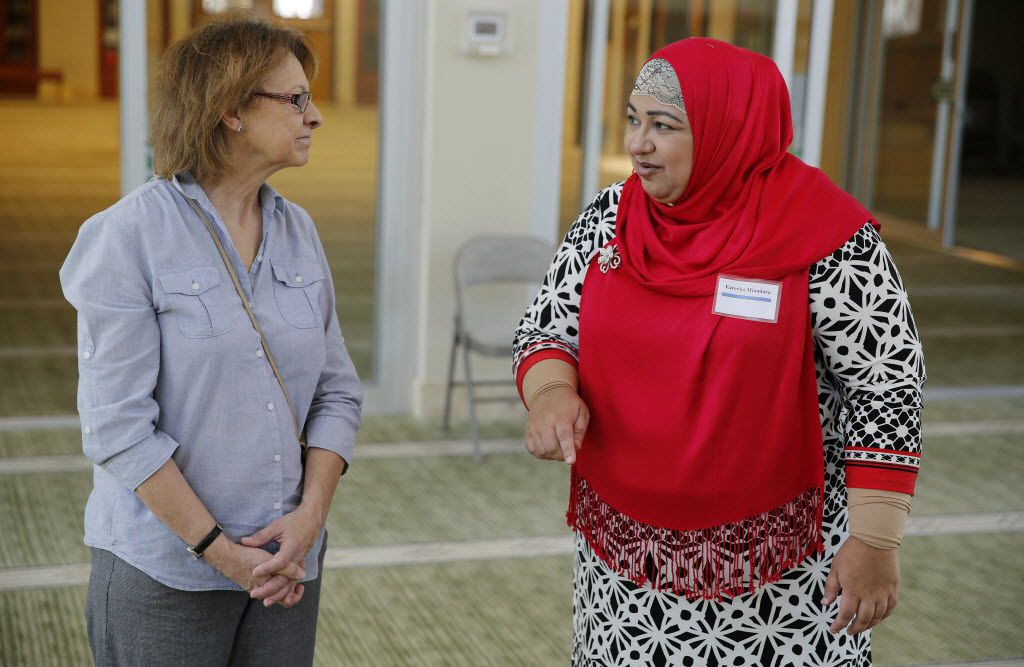 Phyllis Mabbitt (left), of Plano, Texas, listens to tour guide Fareeha Miandara while inside the mosque during the annual Open Mosque Day at the Islamic Association of Collin County in Plano Saturday April 25, 2015. The annual event welcomes the community to meet their muslim neighbors. (Andy Jacobsohn/The Dallas Morning News)