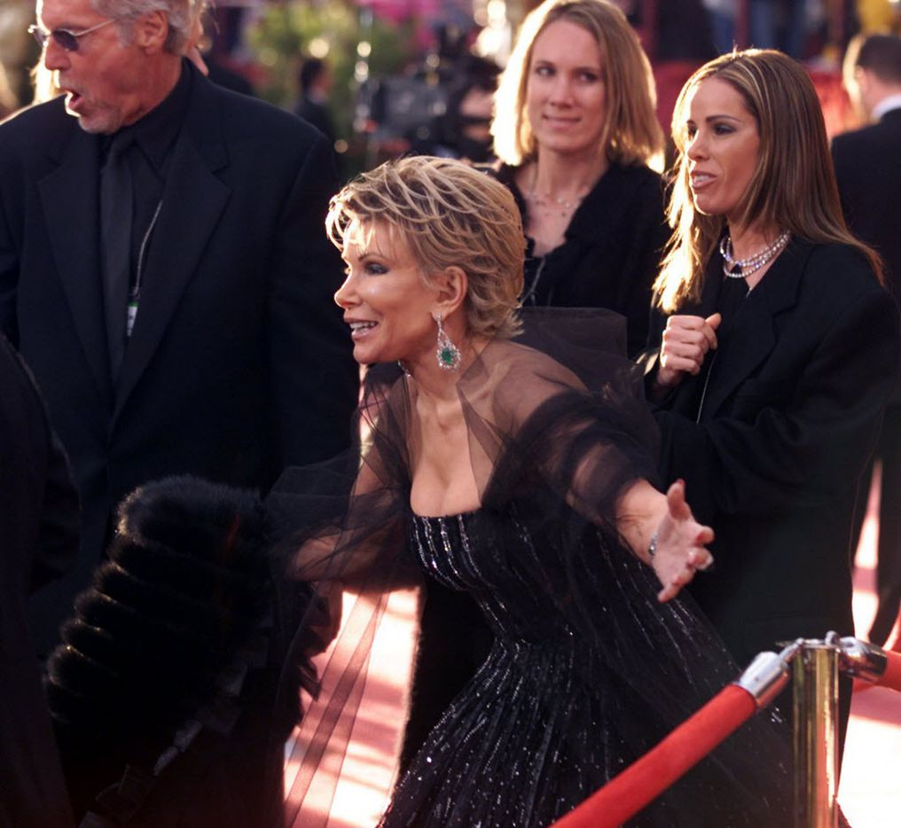 Joan  Rivers and her daughter Melissa stand on the red carpet prior to the start of the 74th Academy Awards in Hollywood on March 24, 2002