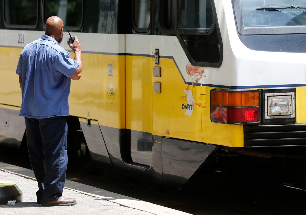 A DART train prepares to move after a Dallas police officer was hit by the train near the intersection of Bryan and Olive streets in downtown Dallas on Tuesday.