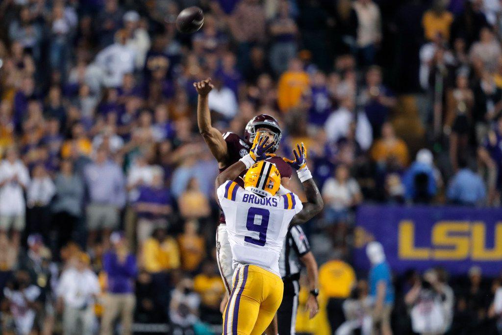 Texas A&M quarterback Kellen Mond throws an interception under pressure from LSU safety Marcel Brooks (9) during the second half of an NCAA college football game in Baton Rouge, La., Saturday, Nov. 30, 2019. LSU won 50-7. (AP Photo/Gerald Herbert)