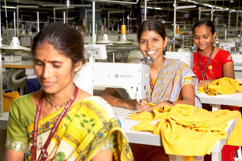 Seamstresses at Alok International make textile goods for Dallas-based Nextt at a huge plant outside Mumbai, India.