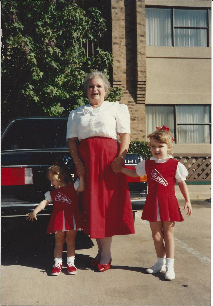 Nancy McCall (center), Nanette Light's grandmother, holds Light's hand (right), then age 4, and her sister Caroline Light Buescher's hand at the girls' first OU-Texas game in 1991. (Submitted by Nancy McCall)