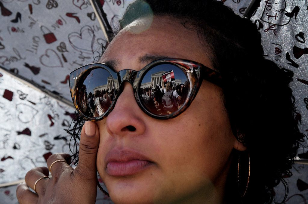 A woman wipes a tear during a protest against U.S. Supreme Court nominee Brett Kavanaugh on Oct. 4, 2018 in Washington, D.C. (Olivier Douliery/Abaca Press/TNS)