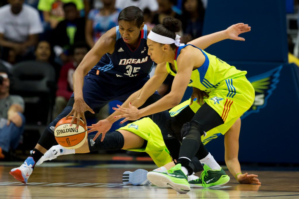 Atlanta Dream guard Angel McCoughtry (35) and Dallas Wings guard Brianna Kiesel (1) fights for a loose ball during the second quarter WNBA basketball game between the Atlanta Dream and Dallas Wings at College Park Center on May 27, 2016 in Arlington, Texas. (Ting Shen/The Dallas Morning News)