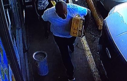 An image taken from surveillance video of a man who police say took hundreds of dollars' worth of power tools from an Arlington business earlier this month while accompanied by his teenage son.