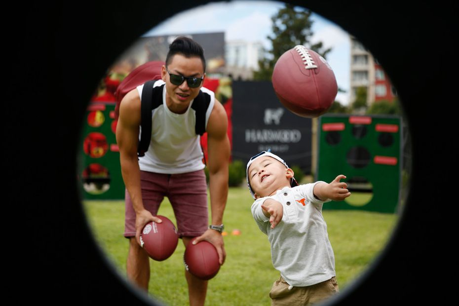 One of our favorite family photos of 2018 was taken at Happiest Hour, one of the top Uber destinations in D-FW in 2018. Here's Lanvin Pham, right, tossing a football with his dad, Bao Pham. ❤️