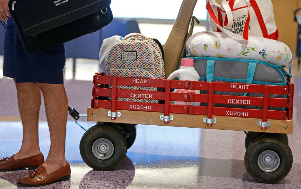 Dallas Independent School District Trustee Miguel Solis pulls a wagon as he prepares to leave the Children's Medical Center, where his daughter Olivia Solis has a heart transplant surgery in Dallas, Tuesday, June 19, 2018. (Jae S. Lee/The Dallas Morning News)
