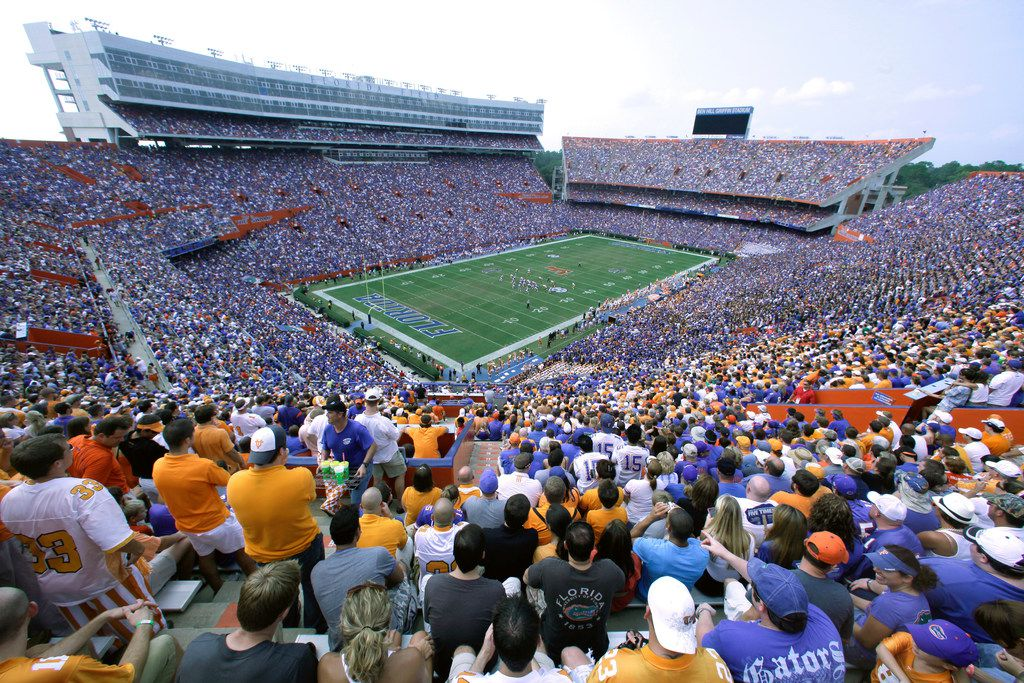 """FILE - In this Sept. 17, 2011, file photo, fans watch an NCAA college football game between Tennessee and Florida at Florida Field (aka The Swamp) in Gainesville, Fla. Florida athletic director Scott Stricklin has a long-term plan to give The Swamp a much-needed face-lift. Stricklin said he wants to """"find ways to upgrade the overall quality"""" of the fan experience inside the outdated football stadium. (AP Photo/Phelan M. Ebenhack, File)"""