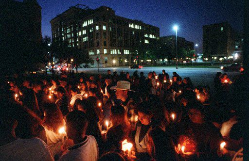 Fans gather at the JFK Memorial in downtown Dallas to honor Selena's memory on March 31, 1995.