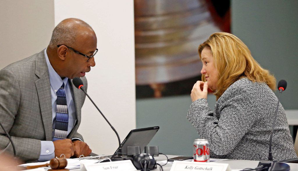 Executive Director Kelly Gottschalk (right) talks with Chairman Sam Friar during the Board of Trustees meeting at Dallas Police and Fire Pension System in Dallas, Thursday, Dec. 8, 2016. Members of the Board of Trustees discussed a variety of topics including the possible changes to DROP policy. (Jae S. Lee/The Dallas Morning News)