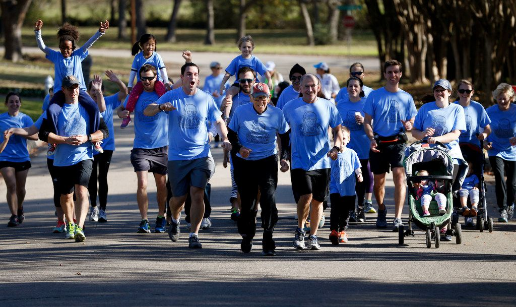 Orville Rogers, who is turning 100-years-old on Nov. 28, runs with his family near White Rock Lake in Dallas on Saturday, Nov. 25. Orville's family members ran a collective 100 miles that morning and finished the last mile with Orville. (Rose Baca/The Dallas Morning News)