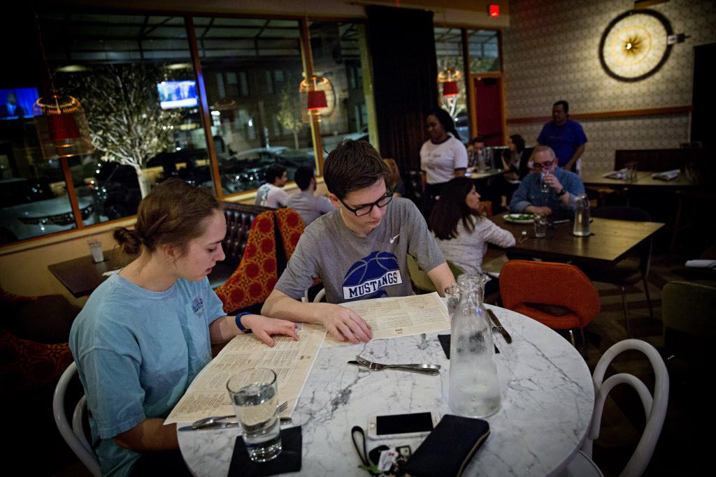Morgan Hosey (left) and her brother, Sean, look over the menu at The Royale Magnificent Burgers Thursday, February 18, 2016 in Plano, Texas. (G.J. McCarthy/The Dallas Morning News)