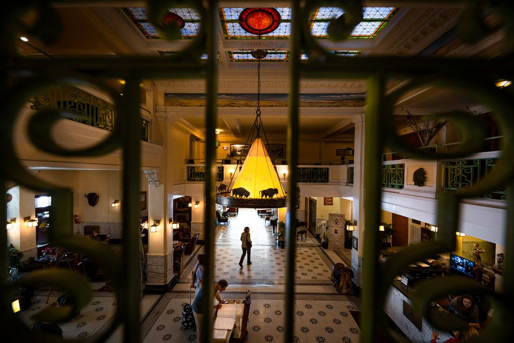 Guests walk through the two-story lobby of the Plains Hotel, the world's first to have telephones in every room, in Cheyenne, Wyo.