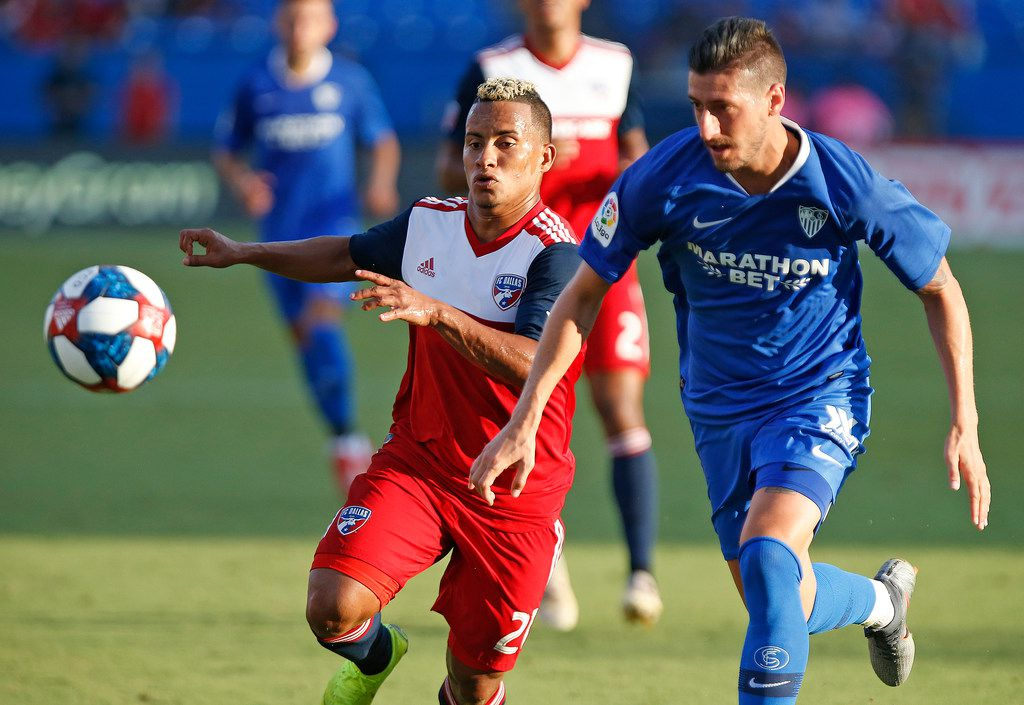 FC Dallas midfielder Michael Barrios (21) races Sevilla defender Sergio Escudero (18) for position during the first half as FC Dallas hosted Sevilla at Toyota Stadium in Frisco on Friday, July 17, 2019.  (Stewart F. House/Special Contributor)