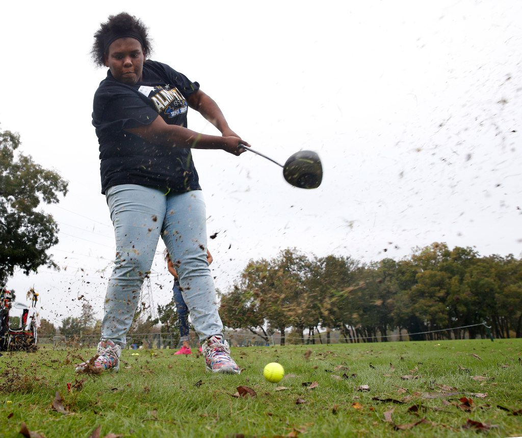 Bri'an Lewis  from Lincoln High School just misses the ball on a drive during Fairway to Success golf program at  Keeton Park Golf Course in Dallas.  (Nathan Hunsinger/The Dallas Morning News)