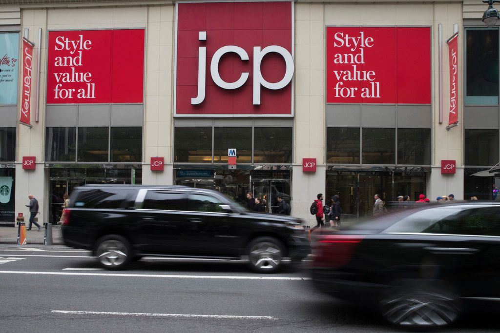 Traffic makes its way past the J.C. Penney store outside the Manhattan Mall in New York.