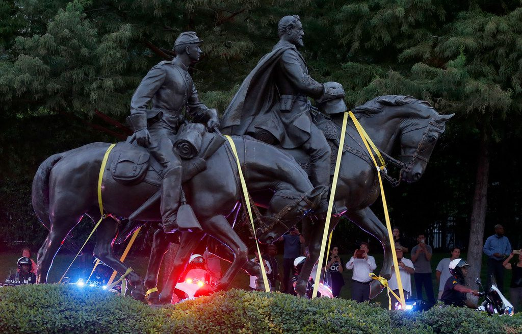 Motorcycle officers start to escort a truck carrying the Robert E. Lee statue at Robert E. Lee Park on Turtle Creek Boulevard in Dallas, Thursday, Sept. 14, 2017. (Jae S. Lee/The Dallas Morning News)
