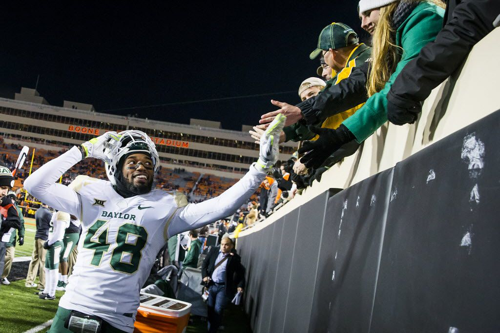 Baylor's Travon Blanchard celebrated with fans in the final seconds of a victory over Oklahoma State in November 2015 in Stillwater, Okla. (File Photo/Smiley N. Pool)