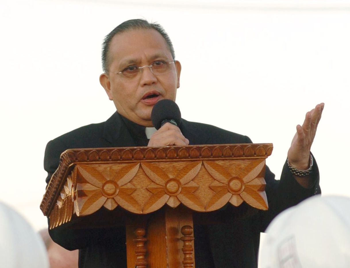 The Rev. Edmundo B. Paredes addressed worshipers during the groundbreaking ceremonies at St. Cecilia Catholic Church.