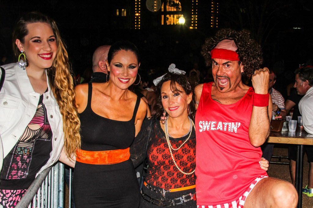 Groups of friends were sweatin' to the '80s at the party.