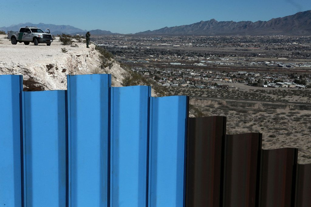 In this Jan. 25, 2017, photo, a Border Patrol agent observes near the fence separating the towns of Anapra, Mexico and Sunland Park, N.M. (AP/Christian Torres)