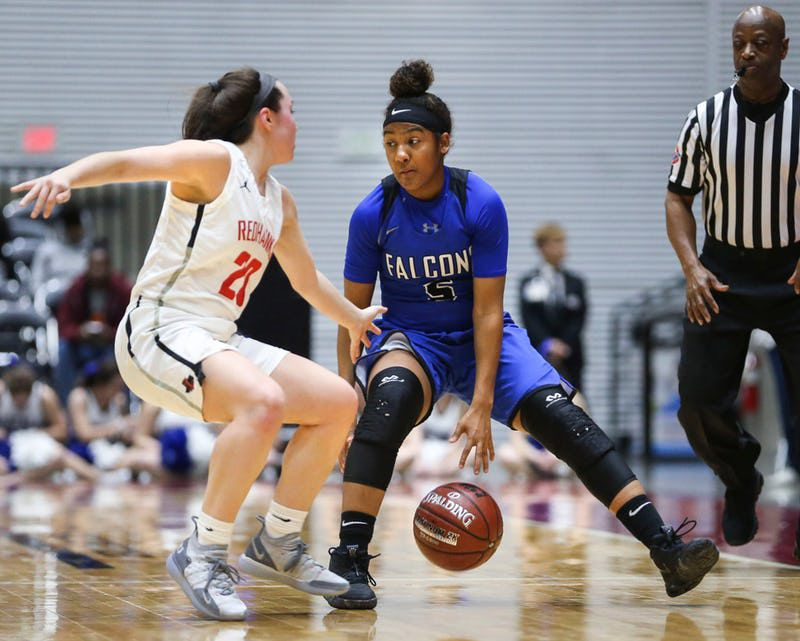 North Forney's Kyndahl Wyatt (5) works to get around Frisco Liberty's Mara Casey (20) during the first half of a girls basketball Class 5A Region II semifinal between Frisco Liberty and North Forney on Friday, Feb. 22, 2019 at the Curtis Culwell Center in Garland, Texas. Frisco Liberty beat North Forney 39-25. (Ryan Michalesko/The Dallas Morning News)