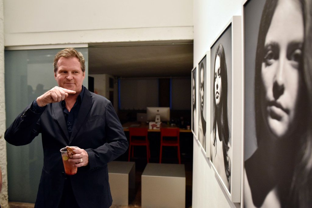 Fredrik Broden speaks about one of his photographs during opening night of his exhibit TWENTY-ONE: The Faces as Landscape at Tractorbeam's gallery in Downtown Dallas, Saturday evening, April 8, 2017. Ben Torres/Special Contributor