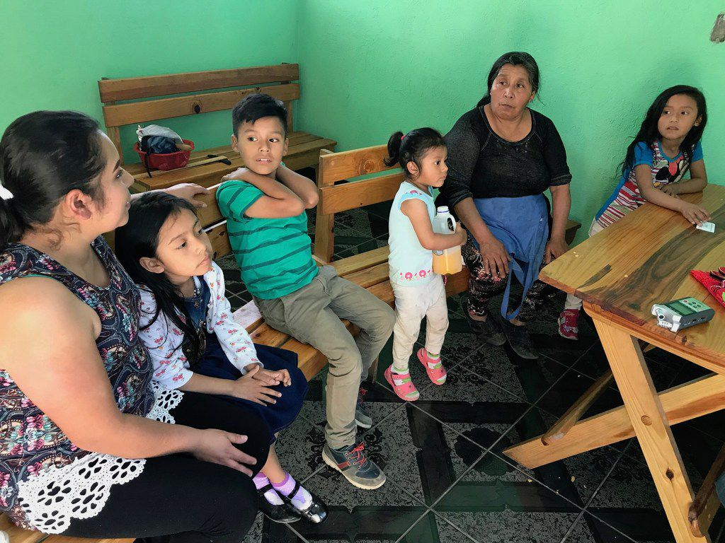 Martina Alvarez sits with her grandchildren and daughter in-law, Clara Vielman, in their grocery and tortillas store in January 2019.