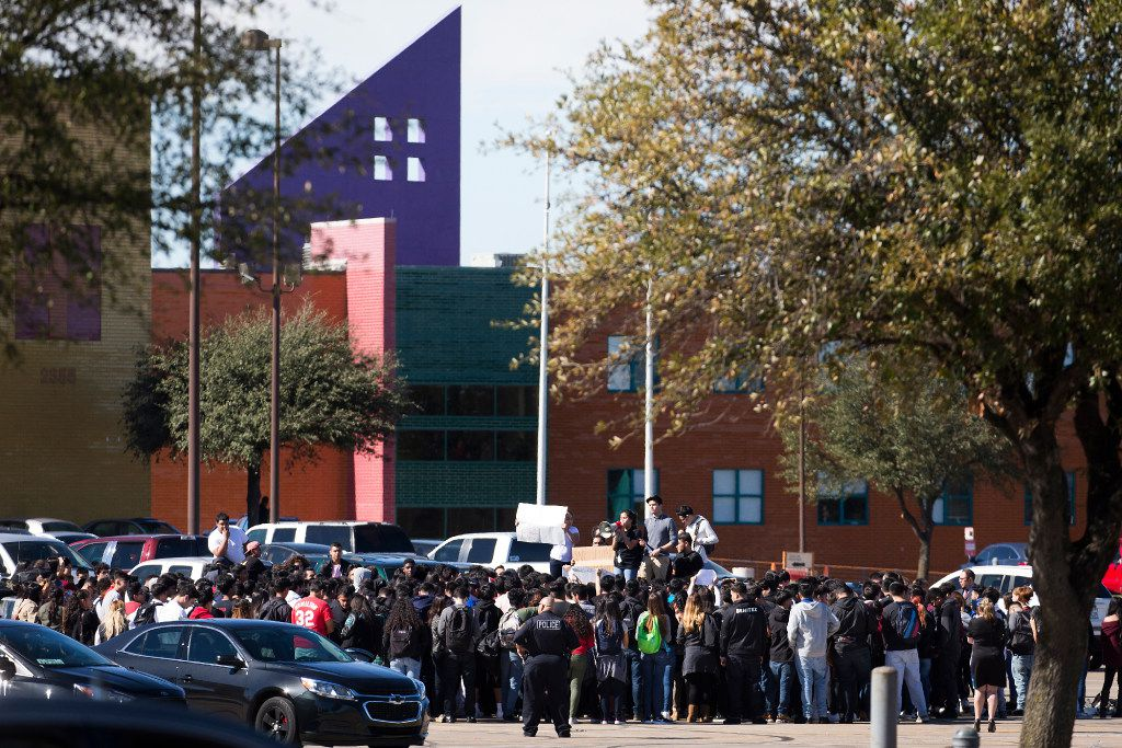 """Students at Moises E. Molina High School walk out of class and rally in the parking lot in support of """"A Day Without Immigrants"""" on Thursday, Feb. 16, 2017, in Dallas. (Smiley N. Pool/The Dallas Morning News)"""