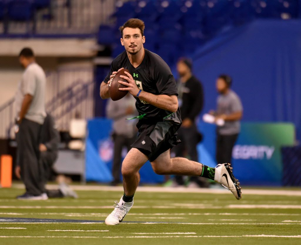 FILE - In this Feb. 27, 2016 file photo, Memphis quarterback Paxton Lynch runs a drill at the NFL football scouting combine, in Indianapolis. The facts about Braxton Miller's potential NFL career are clear: a transition from star quarterback at Ohio State to maybe wide receiver as a pro.  He's sharing the journey with fans through a 360-degree virtual reality video. Not to be outdone, Paxton Lynch _ who will be playing quarterback in the NFL and quite possibly will be a first-round pick in Thursday night's draft _ is taking the same VR route. (AP Photo/L.G. Patterson, File)