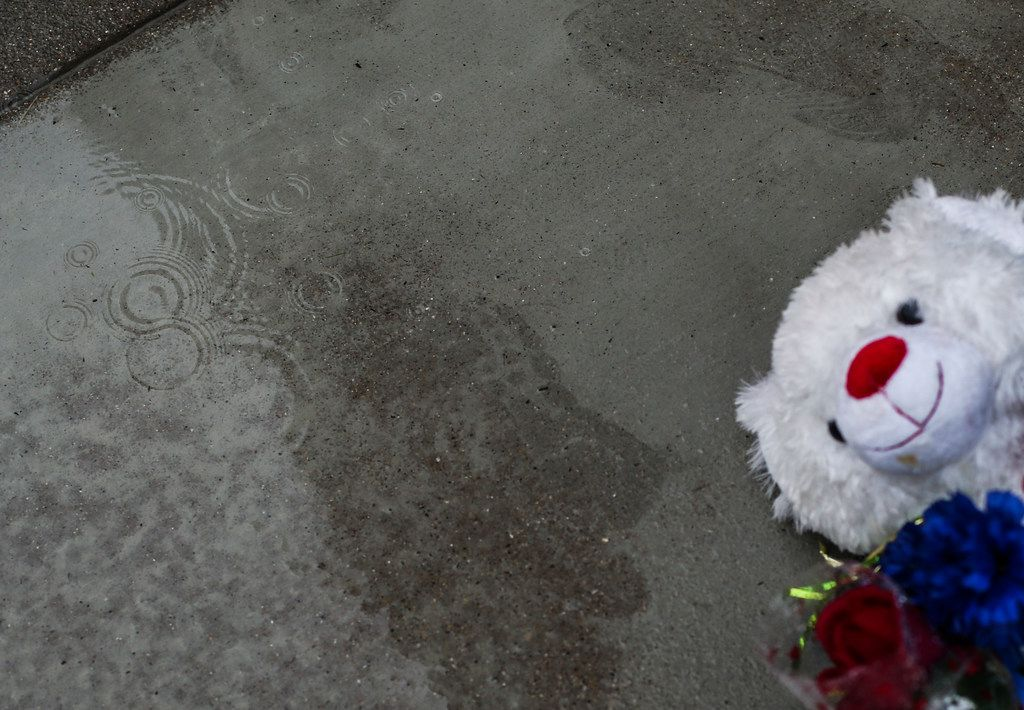 Rain falls at a memorial near where 13-year-old Malik Tyler, of Dallas, was killed after being caught in the crossfire of a shootout near a Pleasant Grove gas station Tuesday evening on Wednesday, June 5, 2019 in Dallas. (Ryan Michalesko/The Dallas Morning News)