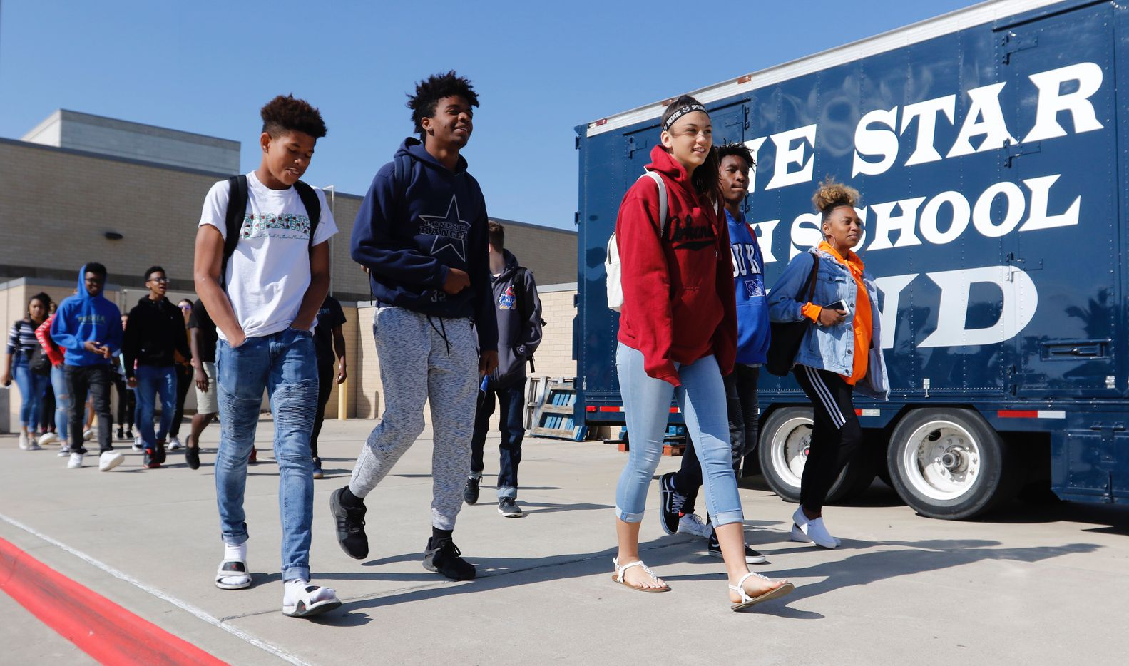 Students from Frisco ISD's Lone Star High School students left the school during the National School Walkout on  Friday morning.