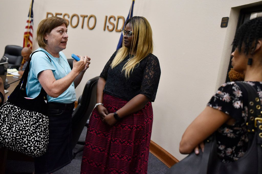 DeSoto trustee Deandrea Fleming, center, talks with community members, including June McDarby, left, of the Don't Close Northside Elementary parent group at a recent meeting.
