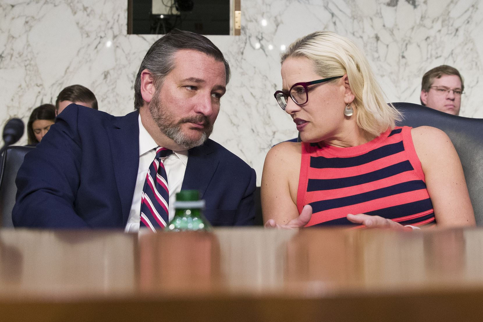 Senate Transportation subcommittee chair Ted Cruz, R-Texas, left, and ranking member Kyrsten Sinema, D-Ariz., talk during a hearing on commercial airline safety, on Capitol Hill, Wednesday, March 27, 2019, in Washington. Two recent Boeing 737 MAX crashes, in Ethiopia and Indonesia, which killed nearly 350 people, have lead to the temporary grounding of models of the aircraft and to increased scrutiny of the FAA's delegation of a number of aspects of the certification process to the aircraft manufacturers themselves.