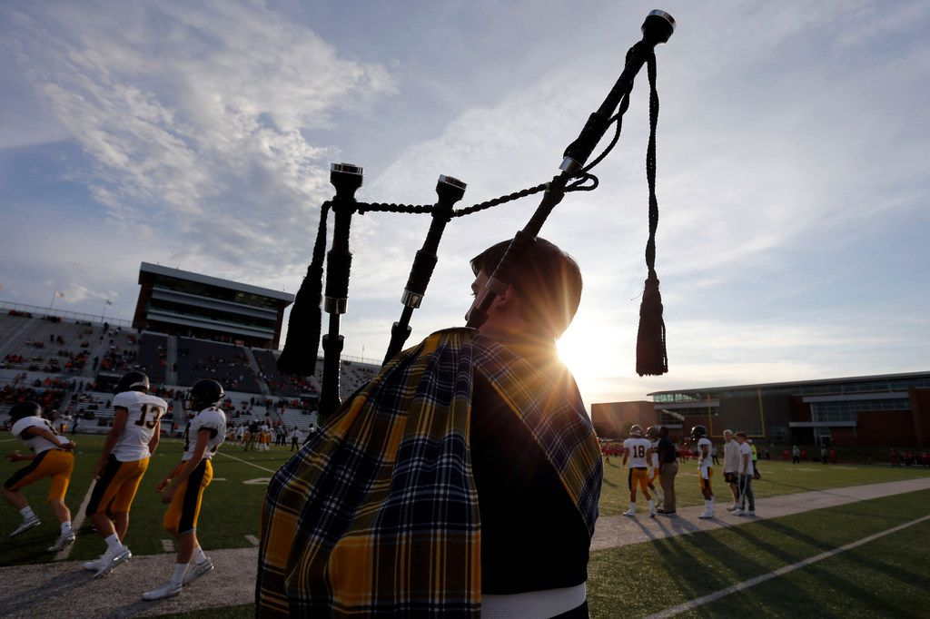 Bagpipe player Robert Tripplett serenades the team during pregame workouts before their high school football game against Rockwall high at Wilkerson-Sanders Stadium in Rockwall on Friday, August 30, 2019. (John F. Rhodes / Special Contributor)