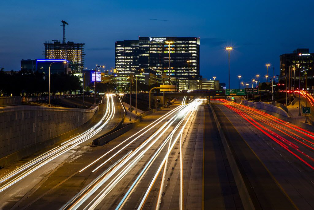 A long exposure shows traffic on the Dallas North Tollway at Tennyson Parkway with the continuing development around Legacy West, Liberty Mutual and The Shops at Legacy in Plano.