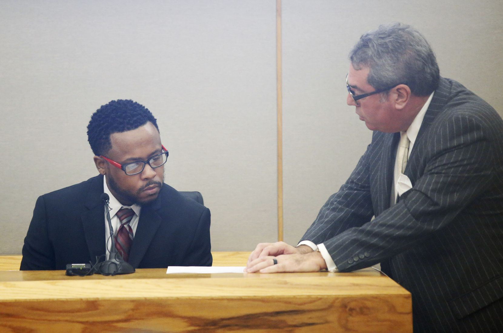Ryan Crawford (left) answered questions from Heath Hyde while on the stand during a hearing for Kaylene Bowen-Wright in the 194th District Court at the Frank Crowley Courts Building in Dallas, on Friday. Bowen-Wright has admitted to subjecting her son Christopher Bowen to unnecessary surgeries, medical treatments and hospital visits over the course of eight years.