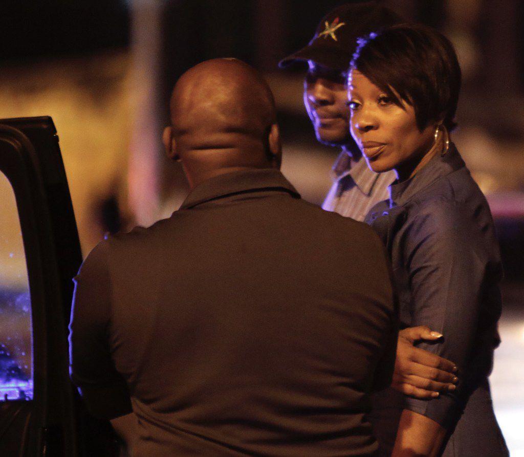 Dallas Police Chief U. Renee Hall talks to Dallas City Manager T. C. Broadnax at the scene of a fatal crane accident.