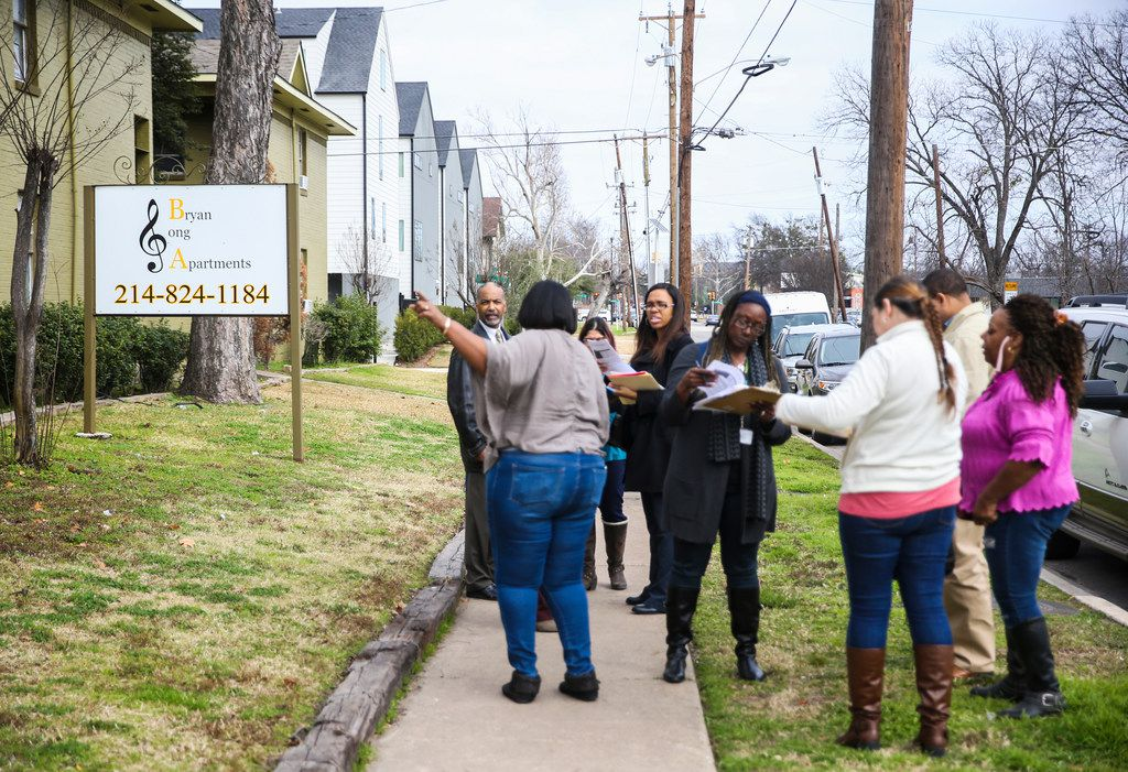 Workers from the city's Fair Housing Department gathered in front of Bryan Song Apartments after conducting a survey of the property's residents Thursday.